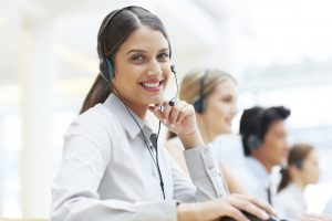 Portrait of a young female customer service agent wearing a headset